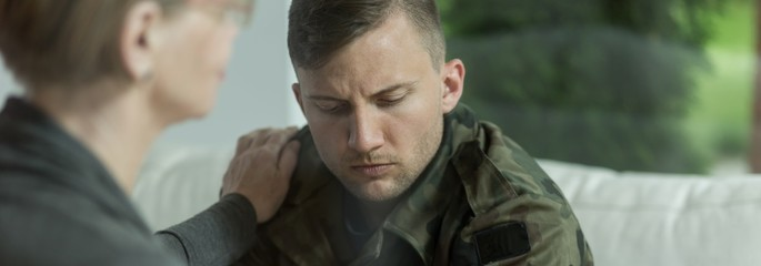 Psychologist comforting soldier with trauma