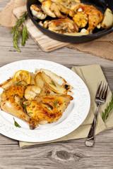 Garlic, Lemon and Rosemary Roasted Chicken. Selective focus.