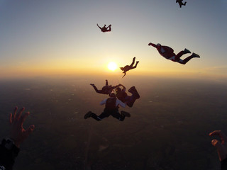 Skydiving group of people at the sunset