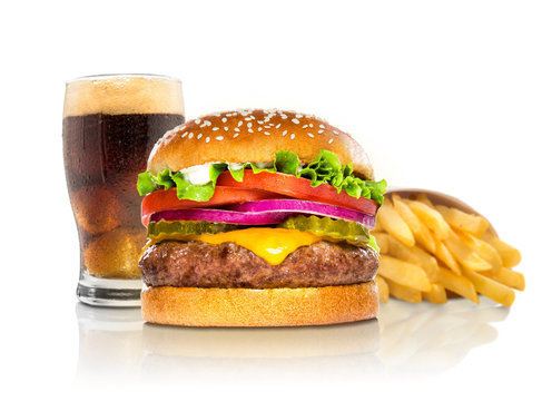 Hamburger fries and a coke soda pop cheeseburger combination deluxe fast food on white