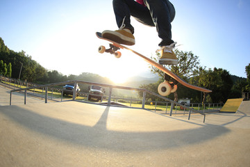 young woman skateboarder skateboarding at skatepark