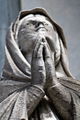 Praying sculpture in the cemetery Recoleta, Buenos Aires Argenti