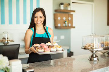 gorgeous woman selling cupcakes - Woman Decorating Cupcakes