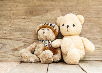 Teddy Bear toy on wood grunge background