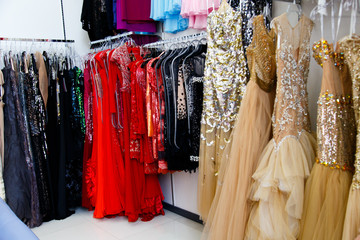 Evening dresses on hangers in store
