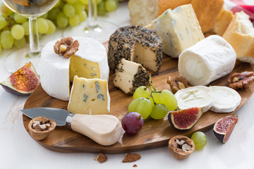 cheese platter, snacks and wine, close-up