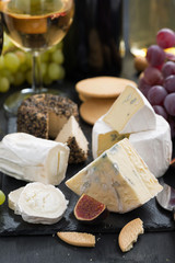 delicacy soft cheeses, fruit and crackers - snacks for wine