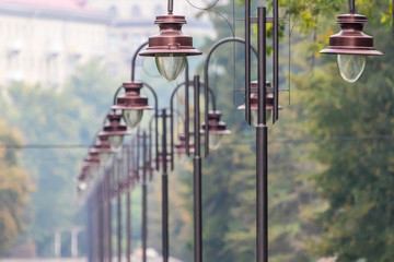 Light stands in a row. Lutsk central park. Ukraine.