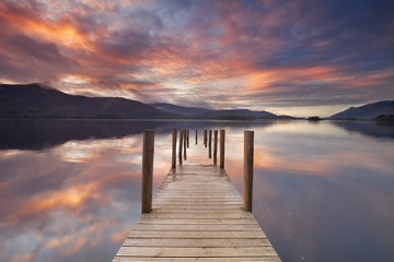 Flooded jetty in Derwent Water, Lake District, England at sunset Wall mural
