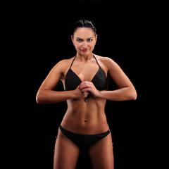 portrait of young beautiful woman black bikini with perfect shape