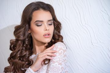 Portrait of a brunette in a lace dress closeup