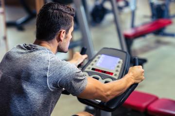 Man workout on a fitness machine