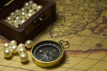 Old compass and on vintage map
