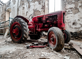 Old, broken tractor indoors