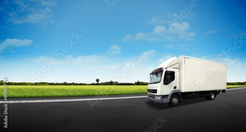 """""""White Delivery Truck on the Road"""" photo libre de droits ..."""