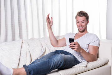 young man likes message on smartphone
