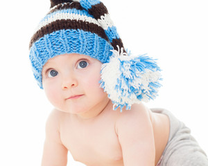 cheerful baby in the blue hat. Beautiful happy baby . One,isolat