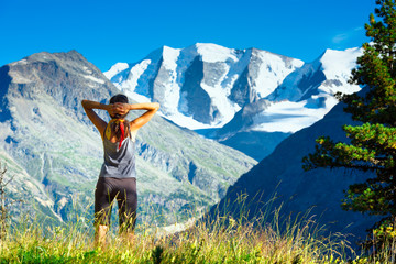 Girl looks at the high mountains during a trek