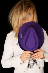 Girl holding purple hat with wild and crazy hair