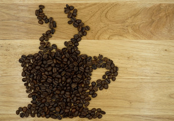 coffee beans in cup style picture on wood block