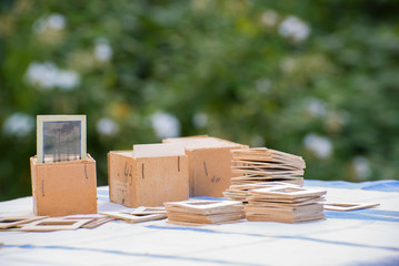Many old slides on the table in garden
