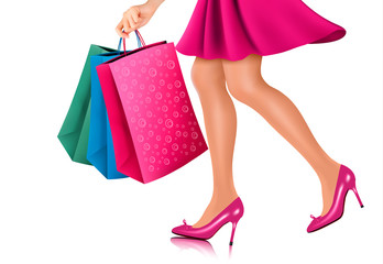 Waist-down view of shopping woman wearing red high heel shoes an