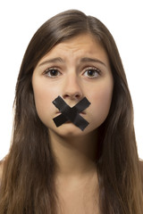 beautiful teenage girl portrait with taped mouth
