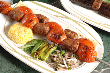 plate of  Kebab with tomato a typical turkish meat dish