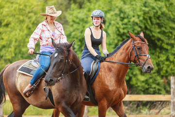 Photo sur cadre textile Equitation Women cowgirl and jocket riding horse. Activity.
