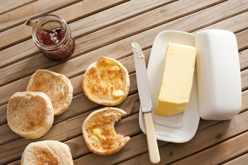 English Muffins, Butter and Jam on Wooden Table