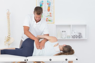 Doctor examining man back