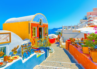 Aluminium Prints Santorini Typical colorful narrow street in Oia the most beautiful village of Santorini island in Greece