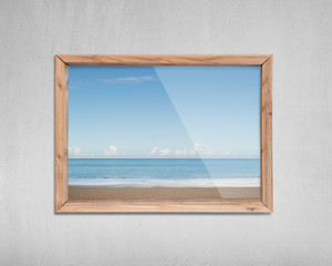 Wooden frame window with view of sky sea beach