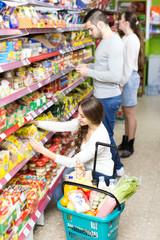 People choosing food in shop