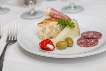 Appetizer Plate of Quiche Meats and Cheeses