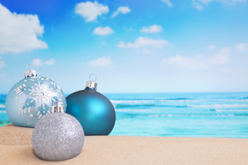 Christmas decorations on the beach, ocean in the back