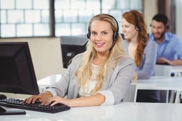 Portrait of beautiful operator working on computer