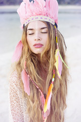 Beautiful young women in indian style feather headress