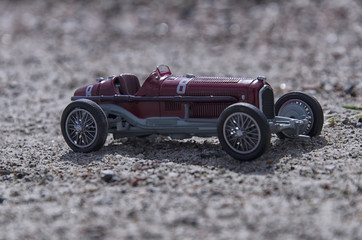 Model of a vintage car in the sun