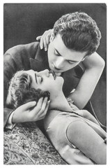 Young romantic erotic sexy couple. Vintage picture