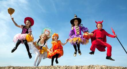 Five Halloween Children Jumping at the Blue Sky