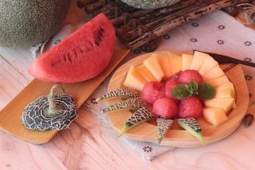 Orange cantaloupe melon fruit juicy on wood background.