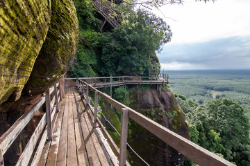 Phu Thok, travel in Thailand. Wooden ladder on the side of the rocky mountains.
