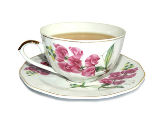 White cup of green tea and saucer with a picture of pink flowers, on white background
