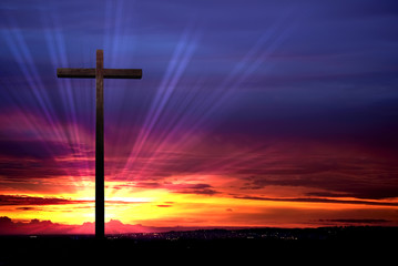 Christian cross on red sunset background Wall mural