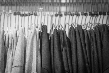Black and white shirt on hangers in a retail shop