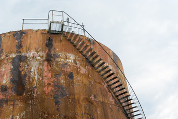 oil reservoir rust sky stair