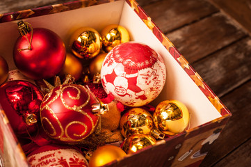 Christmas baubles against a wooden table