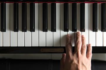 Musician hand on piano