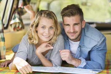 young couple with vintage camper van